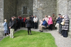 Listening to our guide at the Rock of Cashel in 2015.