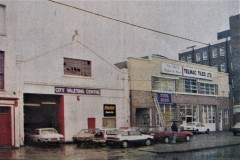 Some of the business premises that stood on Buckingham Place, George's Quay in 1988. Image from the Evening Echo.